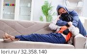 Купить «Armed man assaulting young woman at home», фото № 32358140, снято 15 декабря 2017 г. (c) Elnur / Фотобанк Лори