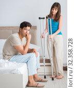 Купить «Young wife supporting husband on crutch after injury», фото № 32358728, снято 9 августа 2017 г. (c) Elnur / Фотобанк Лори