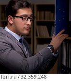 Купить «Businessman almost falling asleep working late hours in the offi», фото № 32359248, снято 25 января 2017 г. (c) Elnur / Фотобанк Лори