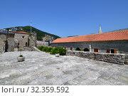 Купить «Budva, Montenegro - June 13.2019. A Landscape in the Old Town», фото № 32359592, снято 13 июня 2019 г. (c) Володина Ольга / Фотобанк Лори