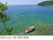 Купить «Beautiful water in shallow water in Mediterranean Sea near Montenegro», фото № 32359928, снято 13 июня 2019 г. (c) Володина Ольга / Фотобанк Лори