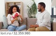 Купить «happy couple with bunch of flowers kissing at home», видеоролик № 32359980, снято 17 октября 2019 г. (c) Syda Productions / Фотобанк Лори