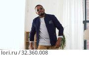 Купить «young african american man dancing at home», видеоролик № 32360008, снято 17 октября 2019 г. (c) Syda Productions / Фотобанк Лори