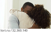 Купить «happy african american couple hugging at home», видеоролик № 32360140, снято 17 октября 2019 г. (c) Syda Productions / Фотобанк Лори