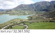 Купить «Panoramic view over Embalse de Zahara inland lake, Andalusia, Spain», видеоролик № 32361592, снято 18 апреля 2019 г. (c) Яков Филимонов / Фотобанк Лори