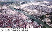 Купить «Aerial view Sevilla of city center with embankment of Guadalquivir. Spain», видеоролик № 32361832, снято 19 апреля 2019 г. (c) Яков Филимонов / Фотобанк Лори