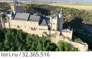 Купить «Aerial view of fortress Alcazar of Segovia. Spain», видеоролик № 32365516, снято 17 июня 2019 г. (c) Яков Филимонов / Фотобанк Лори