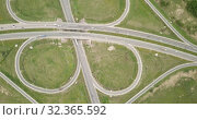 Aerial view above of a new highway road with road junction in Russia. Стоковое видео, видеограф Яков Филимонов / Фотобанк Лори