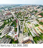 Купить «Aerial city view with crossroads and roads, houses, buildings, parks and parking lots. Sunny summer panoramic image», фото № 32366380, снято 21 января 2020 г. (c) Александр Маркин / Фотобанк Лори