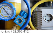 Купить «HVAC Repair Close-Up Vacuum pump, pressure gauge, manifold for Repair and Installation of refrigerators, air conditioners, ventilation, heating», видеоролик № 32366412, снято 2 ноября 2019 г. (c) Mikhail Erguine / Фотобанк Лори