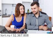 Купить «Young man and woman talking while looking at laptop together», фото № 32367808, снято 6 июля 2018 г. (c) Яков Филимонов / Фотобанк Лори