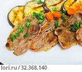 Купить «Slices of mutton with grilled eggplant», фото № 32368140, снято 27 февраля 2020 г. (c) Яков Филимонов / Фотобанк Лори