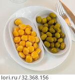 Купить «Green unpitted olives and pickled lupin beans», фото № 32368156, снято 15 ноября 2019 г. (c) Яков Филимонов / Фотобанк Лори