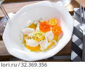 Купить «Ceviche from hake with spicy avocado sauce and cumquat at plate», фото № 32369356, снято 18 ноября 2019 г. (c) Яков Филимонов / Фотобанк Лори
