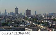 Купить «Панорама современного Бангкока. Вид с вершины храма Золотой горы. Таиланд», видеоролик № 32369440, снято 31 декабря 2018 г. (c) Виктор Карасев / Фотобанк Лори