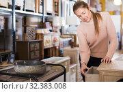 Купить «Female choosing commode in store», фото № 32383008, снято 15 ноября 2017 г. (c) Яков Филимонов / Фотобанк Лори
