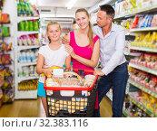 Family standing with purchases. Стоковое фото, фотограф Яков Филимонов / Фотобанк Лори