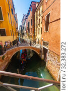 Купить «Gondola in canal of Venice», фото № 32383272, снято 5 сентября 2019 г. (c) Яков Филимонов / Фотобанк Лори