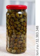 Купить «Glass jar with pickled capers», фото № 32383348, снято 12 декабря 2019 г. (c) Яков Филимонов / Фотобанк Лори