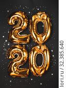 Купить «Happy New year 2020 celebration. Bright gold balloons figures, New Year Balloons with glitter stars on dark background. Christmas and new year celebration. Gold foil balloons 2020», фото № 32385640, снято 2 ноября 2019 г. (c) Сергей Тимофеев / Фотобанк Лори