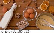 Купить «pot with eggnog, ingredients and spices on wood», видеоролик № 32385732, снято 2 ноября 2019 г. (c) Syda Productions / Фотобанк Лори