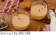 Купить «glasses of eggnog, ingredients and spices on wood», видеоролик № 32385748, снято 2 ноября 2019 г. (c) Syda Productions / Фотобанк Лори