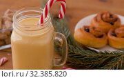 Купить «glass mug of eggnog, ingredients and sweets», видеоролик № 32385820, снято 2 ноября 2019 г. (c) Syda Productions / Фотобанк Лори