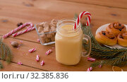 Купить «glass mug of eggnog, ingredients and sweets», видеоролик № 32385836, снято 2 ноября 2019 г. (c) Syda Productions / Фотобанк Лори
