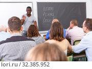 Купить «Adult African American lecturer talking students», фото № 32385952, снято 28 июня 2018 г. (c) Яков Филимонов / Фотобанк Лори
