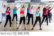 Купить «Group of energetic people of different ages dancing», фото № 32385976, снято 9 октября 2017 г. (c) Яков Филимонов / Фотобанк Лори