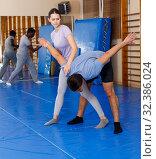 Купить «People practicing self defense techniques», фото № 32386024, снято 31 октября 2018 г. (c) Яков Филимонов / Фотобанк Лори