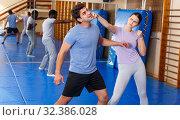 Купить «People practicing self defense techniques», фото № 32386028, снято 31 октября 2018 г. (c) Яков Филимонов / Фотобанк Лори