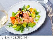 Купить «Tasty seafood ceviche from salmon with avocado, green dill and cumquat», фото № 32386144, снято 21 ноября 2019 г. (c) Яков Филимонов / Фотобанк Лори
