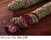 Fuet sausage coated with herbs. Стоковое фото, фотограф Яков Филимонов / Фотобанк Лори
