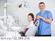 Купить «Smiling girl with positiv stomatologist in dental clinic», фото № 32389216, снято 1 марта 2018 г. (c) Яков Филимонов / Фотобанк Лори