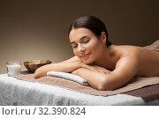 Купить «young woman lying at spa or massage parlor», фото № 32390824, снято 13 октября 2019 г. (c) Syda Productions / Фотобанк Лори