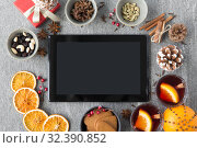 Купить «tablet computer, mulled wine and christmas stuff», фото № 32390852, снято 4 октября 2018 г. (c) Syda Productions / Фотобанк Лори