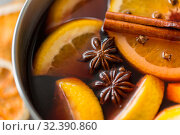 Купить «pot with hot mulled wine, orange slices and spices», фото № 32390860, снято 4 октября 2018 г. (c) Syda Productions / Фотобанк Лори