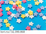 Купить «star shaped pastry sprinkles on blue background», фото № 32390868, снято 11 декабря 2018 г. (c) Syda Productions / Фотобанк Лори