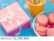 Купить «birthday gift, macarons and paper straws for party», фото № 32390884, снято 11 декабря 2018 г. (c) Syda Productions / Фотобанк Лори