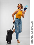 Купить «happy young woman with air ticket and travel bag», фото № 32390928, снято 30 сентября 2019 г. (c) Syda Productions / Фотобанк Лори