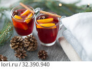 Купить «mulled wine with orange and spices, cones and fir», фото № 32390940, снято 4 октября 2018 г. (c) Syda Productions / Фотобанк Лори
