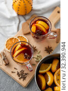 Купить «pot with hot mulled wine, orange slices and spices», фото № 32390944, снято 4 октября 2018 г. (c) Syda Productions / Фотобанк Лори