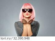 Купить «woman in pink wig and sunglasses sending air kiss», фото № 32390948, снято 30 сентября 2019 г. (c) Syda Productions / Фотобанк Лори
