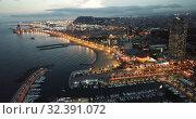 Купить «Famous Barceloneta beach on Mediterranean in Barcelona in night lights», видеоролик № 32391072, снято 27 сентября 2018 г. (c) Яков Филимонов / Фотобанк Лори
