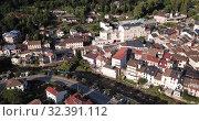 Купить «Aerial view of Ax-les-Thermes with buildings and The Lauze river in France, Midi-Pyrenees», видеоролик № 32391112, снято 19 июля 2019 г. (c) Яков Филимонов / Фотобанк Лори