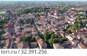 Купить «Picturesque aerial view of Portogruaro cityscape in sunny summer day, Italy», видеоролик № 32391256, снято 4 сентября 2019 г. (c) Яков Филимонов / Фотобанк Лори