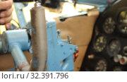 Купить «Close-up, the control wheel of a small aircraft in flight», видеоролик № 32391796, снято 5 ноября 2019 г. (c) Mikhail Erguine / Фотобанк Лори