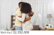 Купить «couple moving to new home, hugging and kissing», видеоролик № 32392008, снято 3 ноября 2019 г. (c) Syda Productions / Фотобанк Лори