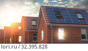 Купить «Row of house with solar panels on roof on blue sky background.», фото № 32395828, снято 27 февраля 2020 г. (c) Maksym Yemelyanov / Фотобанк Лори